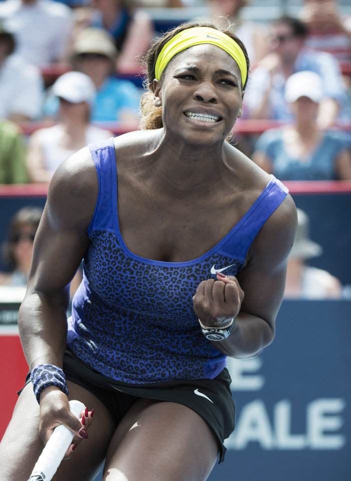 Photo - Serena Williams celebrates a point against Caroline Wozniacki, from Denmark, at the Rogers Cup tennis tournament Friday, Aug. 8, 2014,  in Montreal. Williams defeated Wozniacki 4-6, 7-5, 7-5. (AP Photo/The Canadian Press, Paul Chiasson)