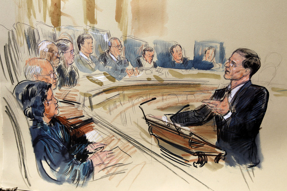 This artist rendering shows attorney Gregory G. Katsas speaking in front of the Supreme Court Justice in Washington, Monday, March 26, 2012, as the court began three days of arguments on the health care law signed by President Barack Obama in Washington. Justices seated, from left are, Sonia Sotomayor, Stephen Breyer, Clarence Thomas, Antonin Scalia, Chief Justice John Roberts and Anthony Kennedy, Ruth Bader Ginsburg, Samuel Alito and Elena Kagan. (AP Photo/Dana Verkouteren) ORG XMIT: DCCD127