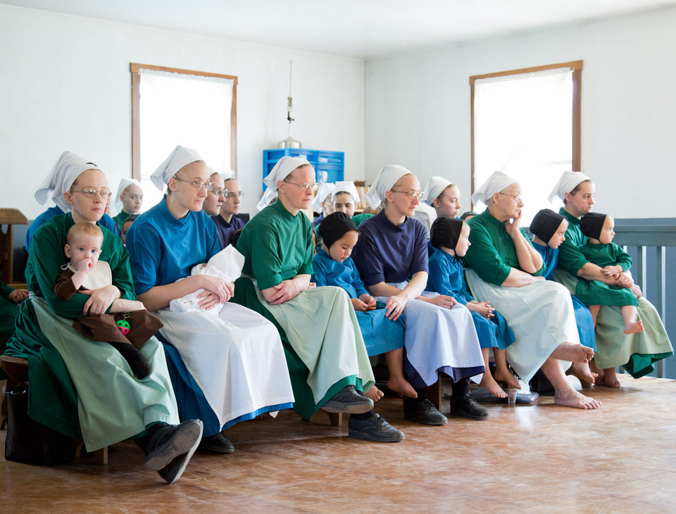 Photo - Amish women fill-up the school house to listen to their children sing during the final day of class on Tuesday, April 9, 2013 in Bergholz, Ohio. (AP Photo/Scott R. Galvin)