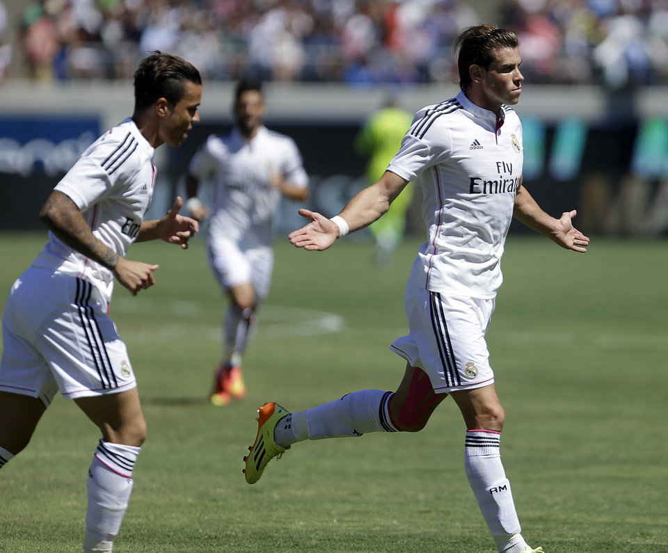 Photo - Real Madrid's Gareth Bale, right, celebrates after scoring a goal against Inter Milan during the first half of a soccer match in the first round of the Guinness International Champions Cup, Saturday, July 26, 2014, in Berkeley, Calif. (AP Photo/Ben Margot)
