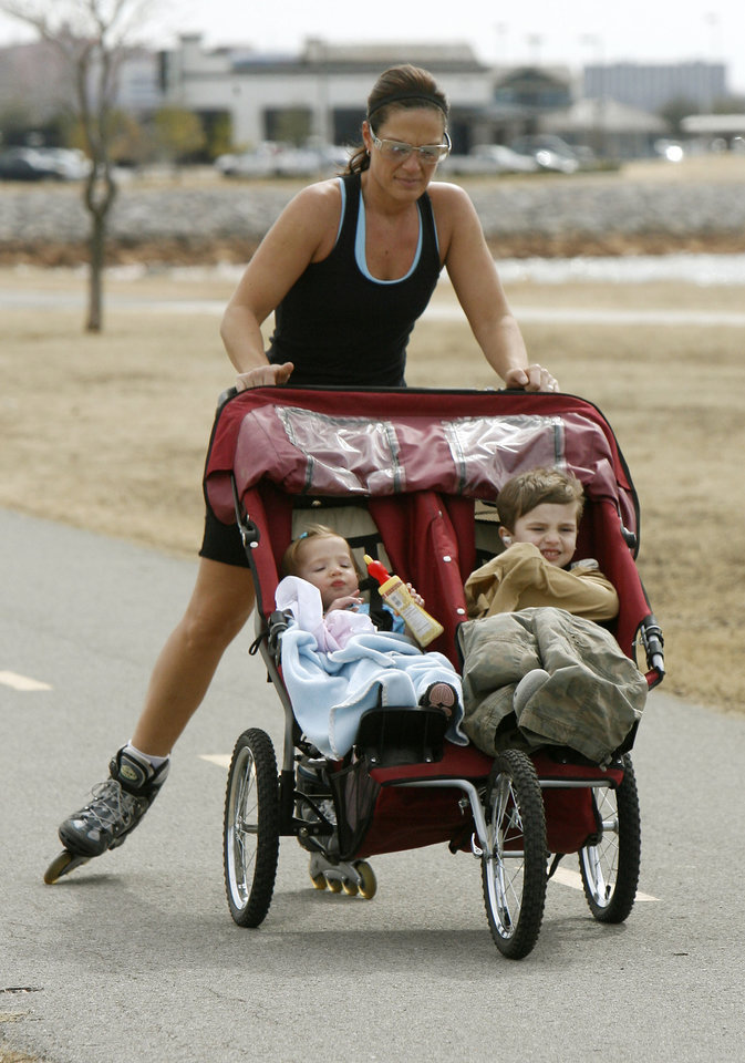 Jeanna Plummer takes advantage of 70 degree weather to roller blade with her children Emma, 20 months, and Aedine, 4, at Lake Hefner in Oklahoma City, OK, Monday, Feb. 25, 2008. BY PAUL HELLSTERN, THE OKLAHOMAN