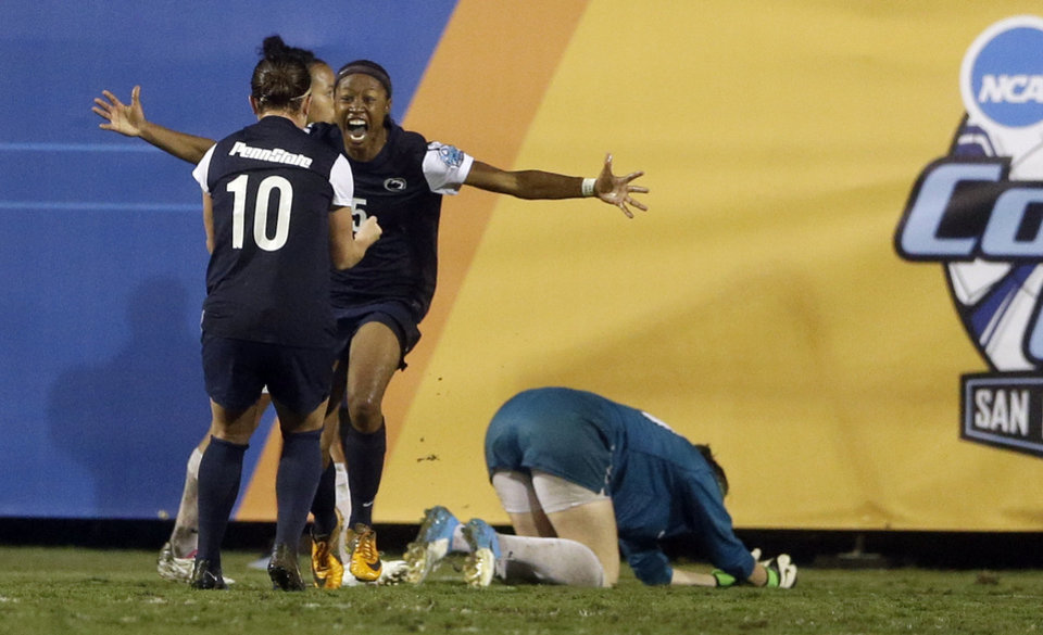 Photo - Penn State's Maya Hayes, facing camera, celebrates with teammate Christine Nairn (10) after scoring on Florida State goalkeeper Kelsey Wys, right, during the second half in an NCAA women's college soccer tournament semifinal, Friday, Nov. 30, 2012, in San Diego. (AP Photo/Gregory Bull)