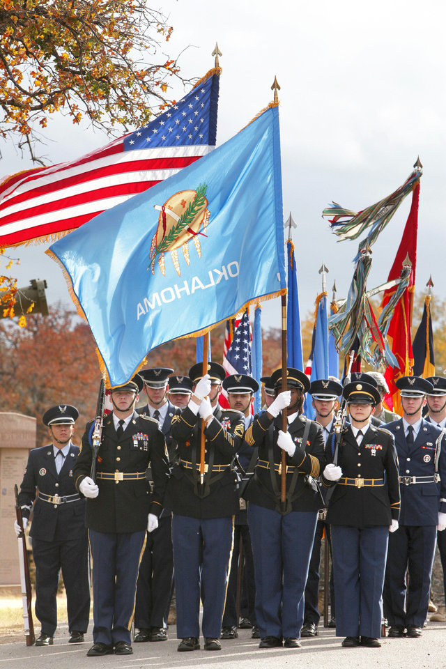Members of various honor guards march during the annual Veteran�s Day ceremony Saturday at the 45th Infantry Museum in Oklahoma City. Photo By Paul Hellstern, The Oklahoman