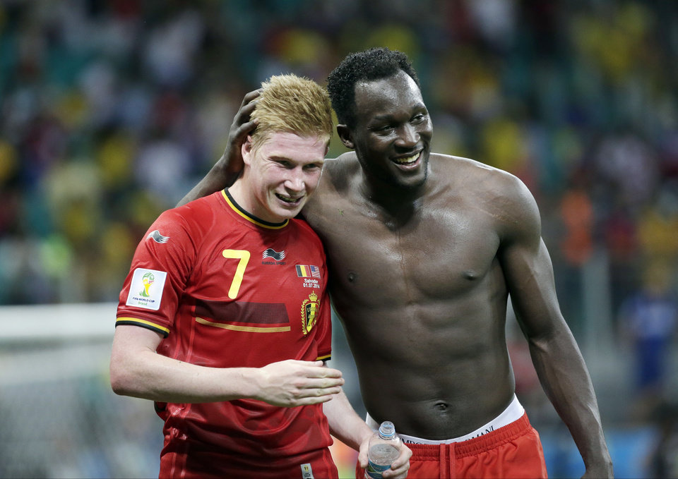 Photo - Belgium's  Kevin De Bruyne, left, and Romelu Lukaku, right, celebrate after the World Cup round of 16 soccer match between Belgium and the USA at the Arena Fonte Nova in Salvador, Brazil, Tuesday, July 1, 2014. Belgium held on to beat US 2-1 in extra time.(AP Photo/Felipe Dana)