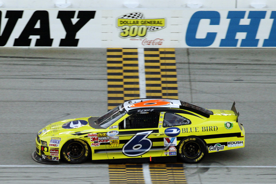 Photo -   Ricky Stenhouse Jr., crosses the finish line to win the NASCAR Nationwide Series auto race at Chicagoland Speedway in Joliet, Ill., Saturday, Sept. 15, 2012. (AP Photo/Nam Y. Huh)