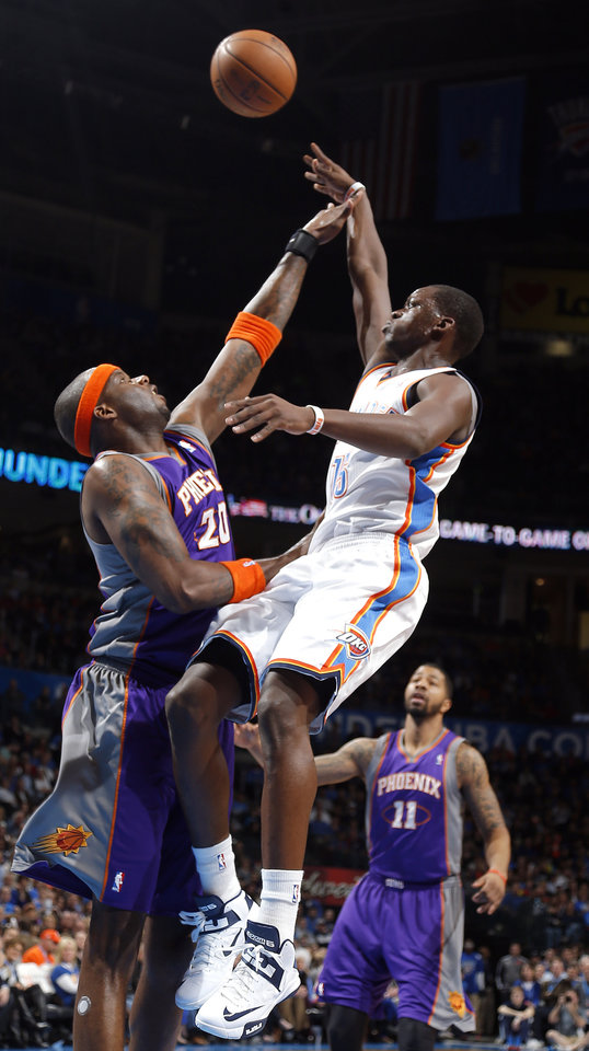 Photo - Oklahoma City's Reggie Jackson (15) shoots over Phoenix' Jermaine O'Neal (20) during the NBA game between the Oklahoma City Thunder and the Phoenix Suns at theChesapeake Energy Arena, Friday, Feb. 8, 2013.Photo by Sarah Phipps, The Oklahoman