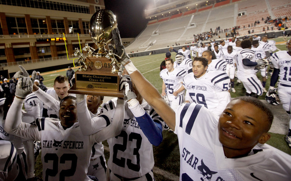 Photo - Members of the Star Spencer football team celebrate after winning the Class 4A high school football state championship game betweeen Star Spencer Douglass at Boone Pickens Stadium in Stillwater, Okla., Saturday, December 5, 2009. Photo by Bryan Terry, The Oklahoman