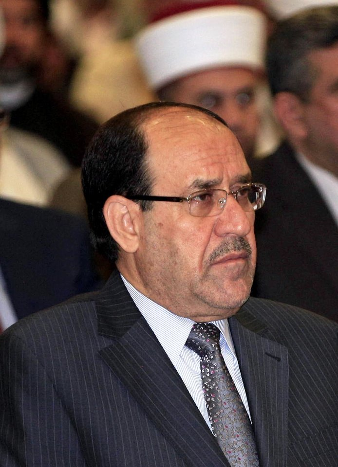 Photo - Iraqi Prime Minister Nouri al-Maliki attends the Convergence of religions conference in Baghdad, Iraq, Saturday, April 27, 2013. Gunmen killed 10 people in Iraq, including five soldiers near the main Sunni protest camp west of Baghdad, the latest in a wave of violence that has raised fears the country faces a new round of sectarian bloodshed. The attack on the army intelligence soldiers in the former insurgent stronghold of Ramadi drew a quick response from al-Maliki, whose Shiite-led government has been the target of rising Sunni anger over perceived mistreatment.(AP Photo/Karim Kadim)