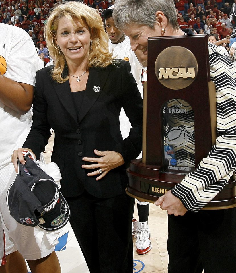 Photo - OU coach Sherri Coale waits for the Regional Champions trophey after OU's win in the NCAA women's basketball regional  tournament finals between Oklahoma and Purdue at the Ford Center in Oklahoma City, Tuesday, March 31, 2009.  OU won, 74-68. Photo by Bryan Terry, The Oklahoman