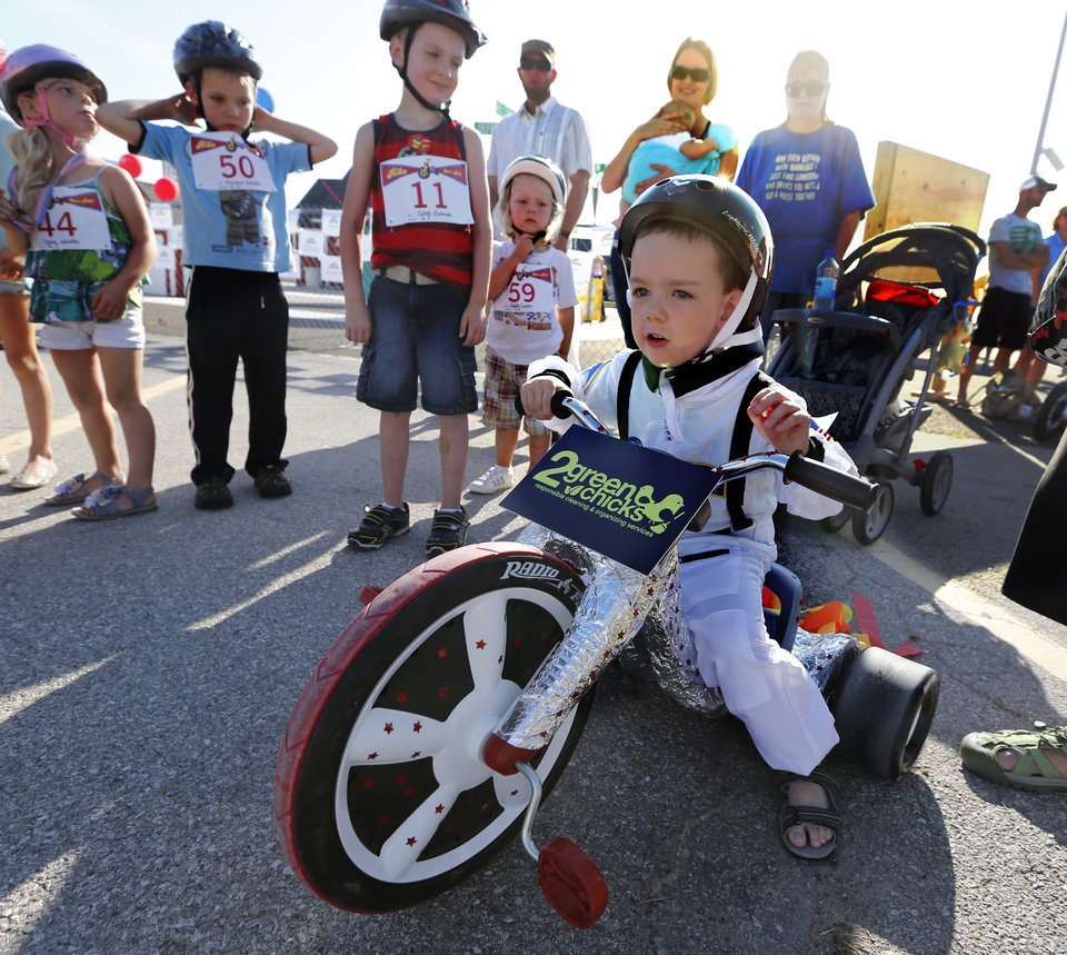 Photo -  Keegan King, 4, prepares for his heat Saturday as children participate in The Ride, a race in Norman benefiting United Way. PHOTO BY STEVE SISNEY, THE OKLAHOMAN   STEVE SISNEY -