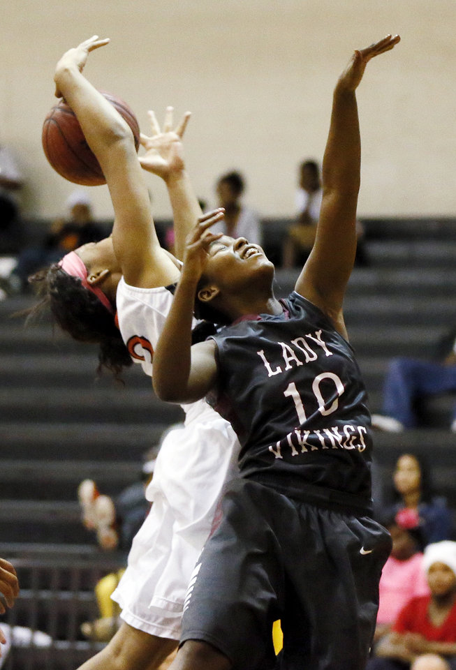 Northeast's T'ona Edwards (10) and Nia Stepeny (3) of Douglass chase a rebound during a girls high school basketball game between Douglass and Northeast at Douglass High School in Oklahoma City, Friday, Feb. 8, 2013. Photo by Nate Billings, The Oklahoman