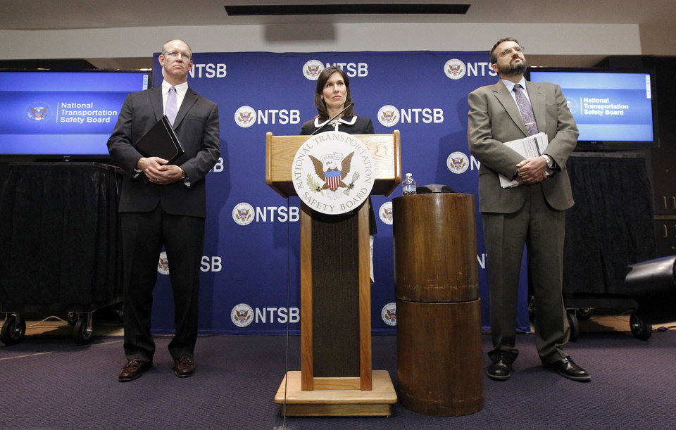 Photo - National Transportation Safety Board (NTSB) Chair Deborah Hersman, center, accompanied by John DeLisi, director of NTSB Office of Aviation Safety, left, and Dr. Joseph Kolly, right, director, NTSB Office of Research and Engineering, speaks  during a news conference in Washington, Thursday,  Feb. 7, 2013, to provide an update on the NTSB's investigation into the Jan. 7 fire that occurred on a Japan Airlines Boeing 787 at Logan International Airport in Boston.  (AP Photo/Ann Heisenfelt)