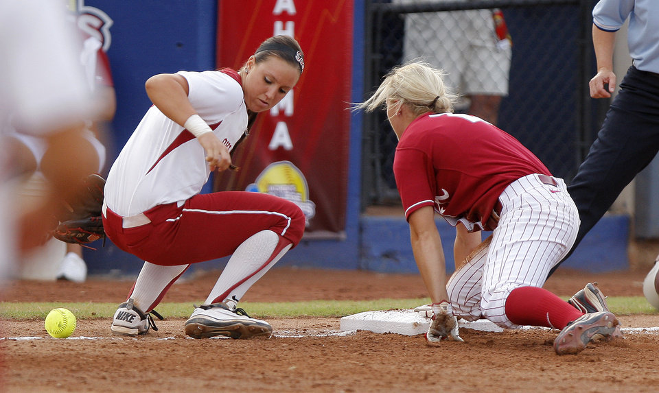 Photo - Oklahoma's Javen Henson (7) looks for the ball as Alabama's Jazlyn Lunceford (2) makes it to third base in the second inning during the championship game of the Women's College World Series as ASA Stadium in Oklahoma City, Tuesday, June 5, 2012. Photo by Bryan Terry, The Oklahoman
