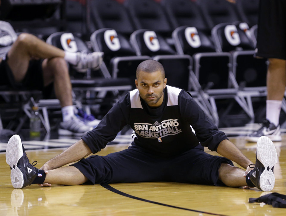 Photo - San Antonio Spurs point guard Tony Parker of France, stretches during NBA basketball practice, Wednesday, June 19, 2013, at the American Airlines Arena in Miami. The Spurs take on the Miami Heat in Game 7 of the NBA Finals on Thursday in Miami. (AP Photo/Wilfredo Lee)