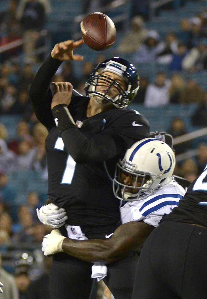 Jacksonville Jaguars quarterback Chad Henne (7) is hit as he throws a pass by Indianapolis Colts linebacker Justin Hickman during the second half of an NFL football game in Jacksonville, Fla., Thursday, Nov. 8, 2012. The Colts won 27-10.(AP Photo/Phelan M. Ebenhack)