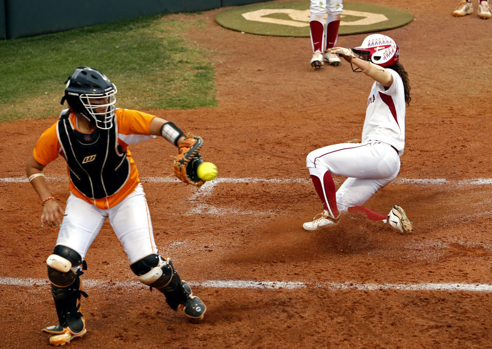Photo - Oklahoma's Callie Parsons scores the first run with catcher Annie Aldrete at the plate as the University of Oklahoma Sooner (OU) softball team plays Tennessee in the first game of the NCAA super regional at Marita Hynes Field on May 23, 2014 in Norman, Okla. Photo by Steve Sisney, The Oklahoman