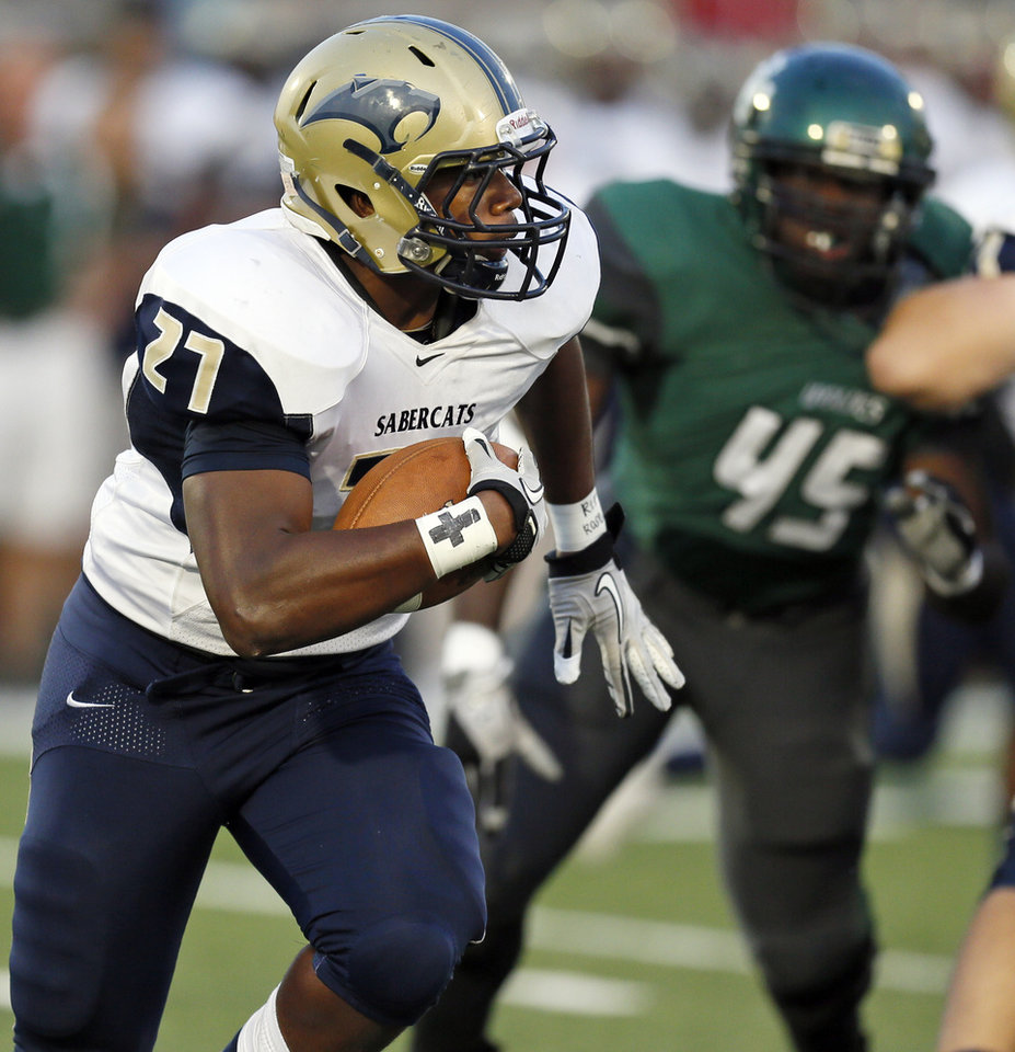 Photo - Southmoore's Karltrell Henderson (27) carries the ball during a high school football game between Edmond Santa Fe and Southmoore at Wantland Stadium in Edmond, Okla., Thursday, Sept. 20, 2012. Photo by Nate Billings, The Oklahoman