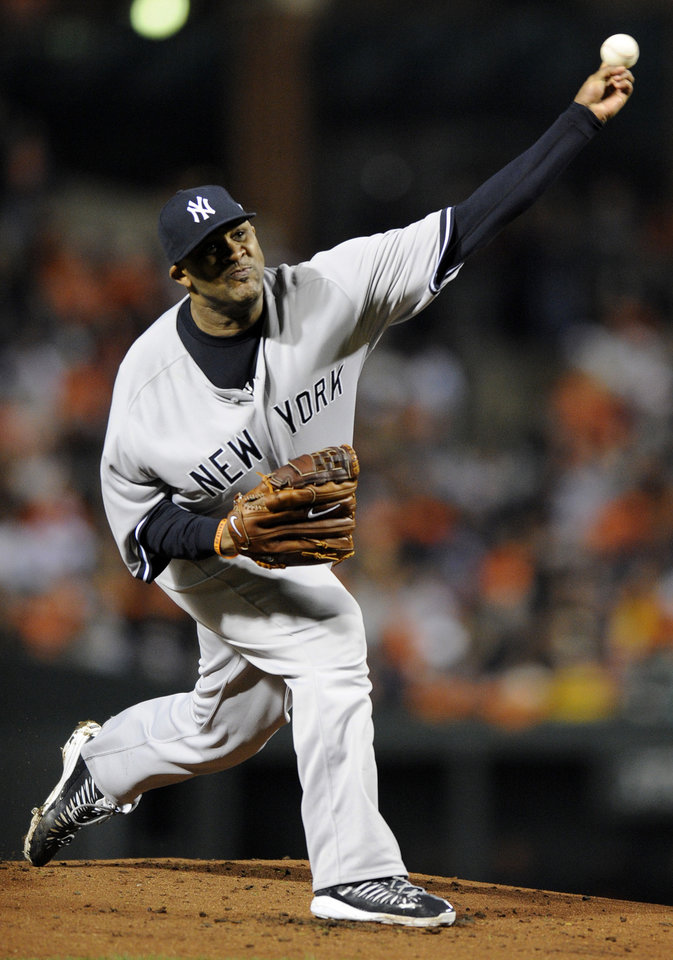 Photo -   New York Yankees starting pitcher CC Sabathia throws to the Baltimore Orioles in the first inning of Game 1 of the American League division baseball series on Sunday, Oct. 7, 2012, in Baltimore. (AP Photo/Nick Wass)