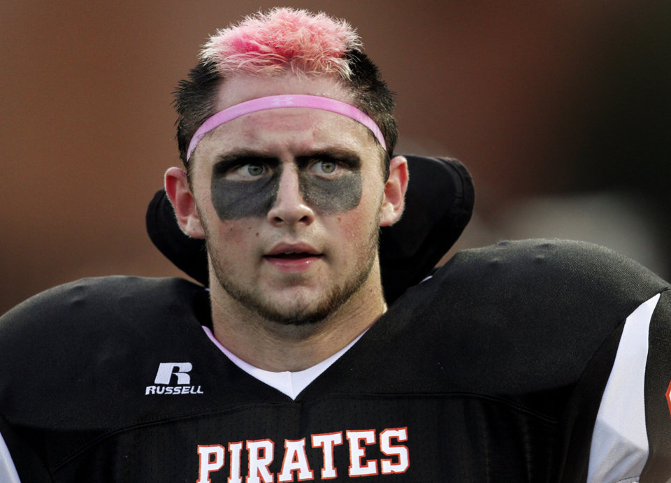 Photo - Putnam City player Josh Gershon wears pink in support of Win-Win Week during a high school football game between Putnam City and Choctaw in Oklahoma CIty, Thursday, September 16,  2010.  Photo by Bryan Terry, The Oklahoman