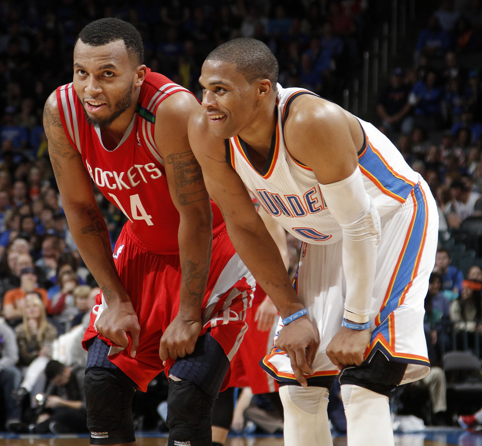 Houston's Daequan Cook (14) and Oklahoma City 's Russell Westbrook (0) talk during the NBA basketball game between the Houston Rockets and the Oklahoma City Thunder at the Chesapeake Energy Arena on Wednesday, Nov. 28, 2012, in Oklahoma City, Okla.   Photo by Chris Landsberger, The Oklahoman