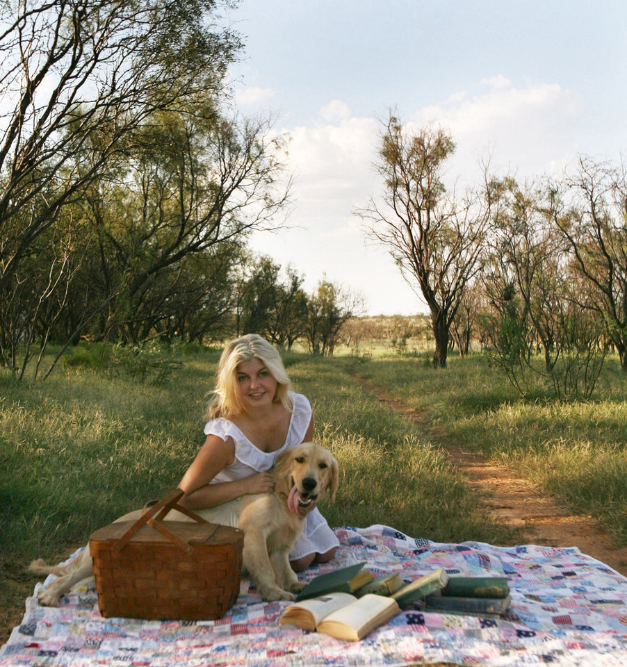 Photographer Samantha Lamb and her dog Harold are pictured on her Hobart farm. Photo provided.