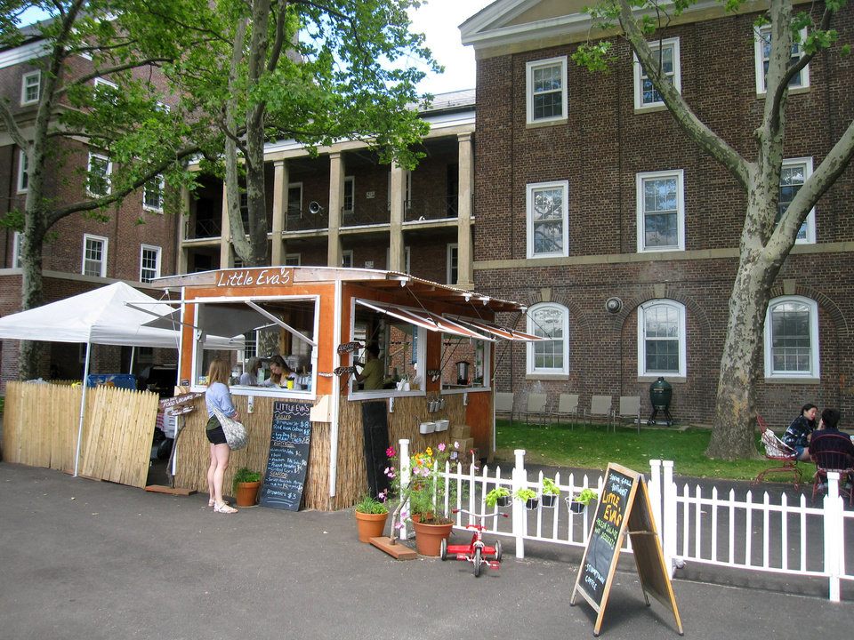Photo - This June 6, 2014 photo shows a food vendor on Governors Island in New York City. The island, a former Coast Guard facility, is now a national park and recreation site, open daily to visitors through the summer. It's dotted with green lawns, outdoor art and historic buildings and it offers a variety of food, events and activities, along with scenic views of Manhattan. (AP Photo/Beth J. Harpaz)