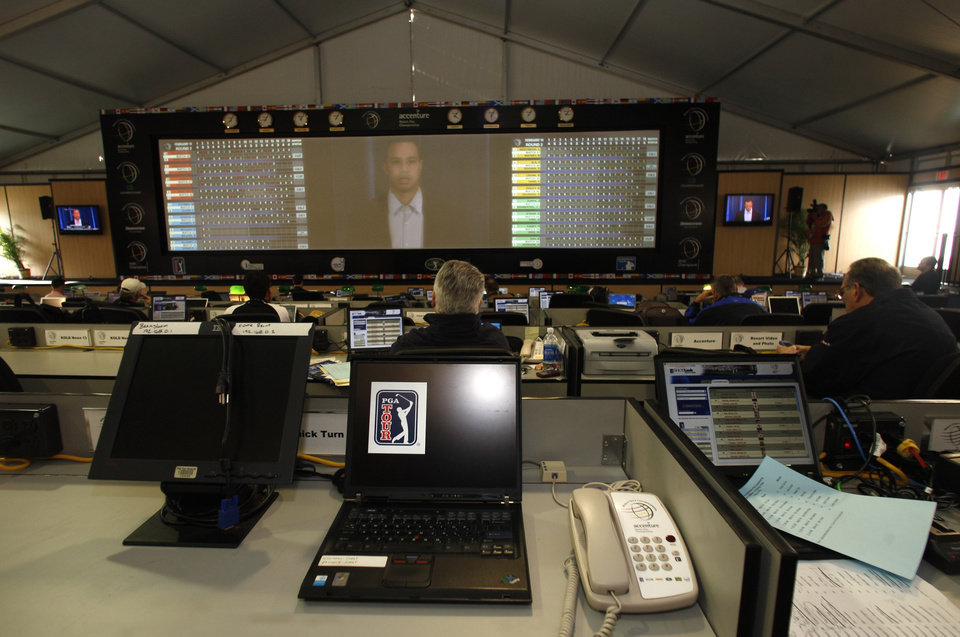 Photo - Tiger Woods appears on the big screen in the press pavilion at the Accenture Match Play Championship golf tournament Friday, Feb. 19, 2010, in Marana, Ariz.  (AP Photo/Lenny Ignelzi) ORG XMIT: AZLI101