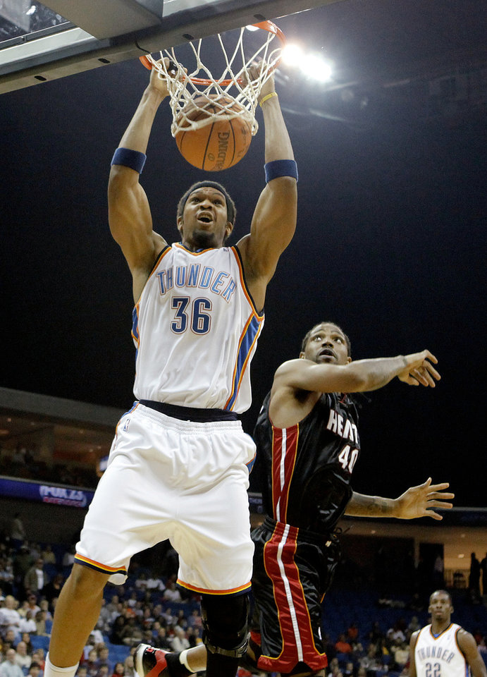 Oklahoma City's Etan Thomas dunks the ball over Miami's Udonis Haslem during an NBA preseason game between the Oklahoma City Thunder and the Miami Heat at the BOK Center in Tulsa, Okla., Wednesday, October 14, 2009. Photo by Bryan Terry, The Oklahoman