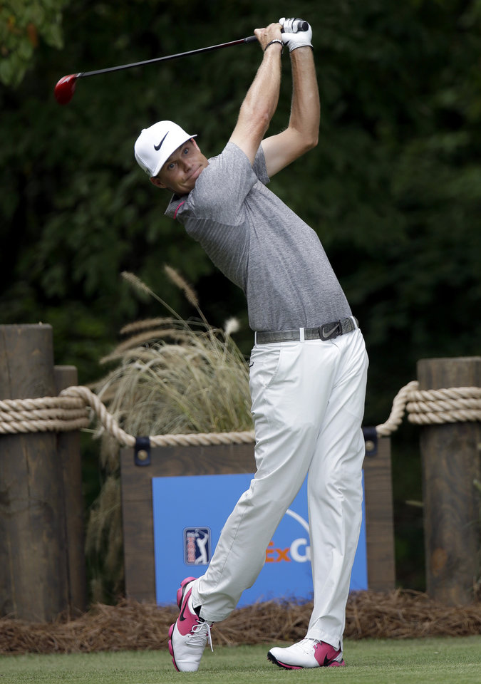 Photo - Nick Watney hits a tee shot on the second hole during the final round of the Wyndham Championship golf tournament in Greensboro, N.C., Sunday, Aug. 17, 2014. (AP Photo/Gerry Broome)