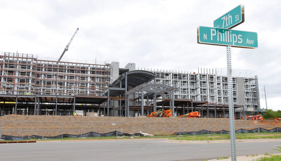Photo -  Construction is expected to be complete this fall on an Embassy Suites hotel at NE 7 and Phillips Avenue in Oklahoma City. Photo by Paul B. Southerland, The Oklahoman   PAUL B. SOUTHERLAND