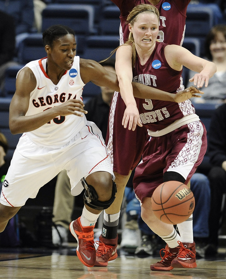 Photo - Georgia's Krista Donald, left, and Saint Joseph's Erin Shields, right, battle for the ball during the first half of a first-round game of the NCAA women's college basketball tournament, Sunday, March 23, 2014, in Storrs, Conn. (AP Photo/Jessica Hill)