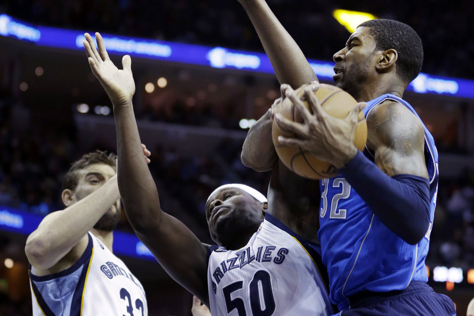Dallas Mavericks\' O.J. Mayo (32) pulls down an offensive rebound over Memphis Grizzlies\' Marc Gasol (33), of Spain, and Zach Randolph (50) during the first half of an NBA basketball game in Memphis, Tenn., Friday, Dec. 21, 2012. (AP Photo/Danny Johnston)