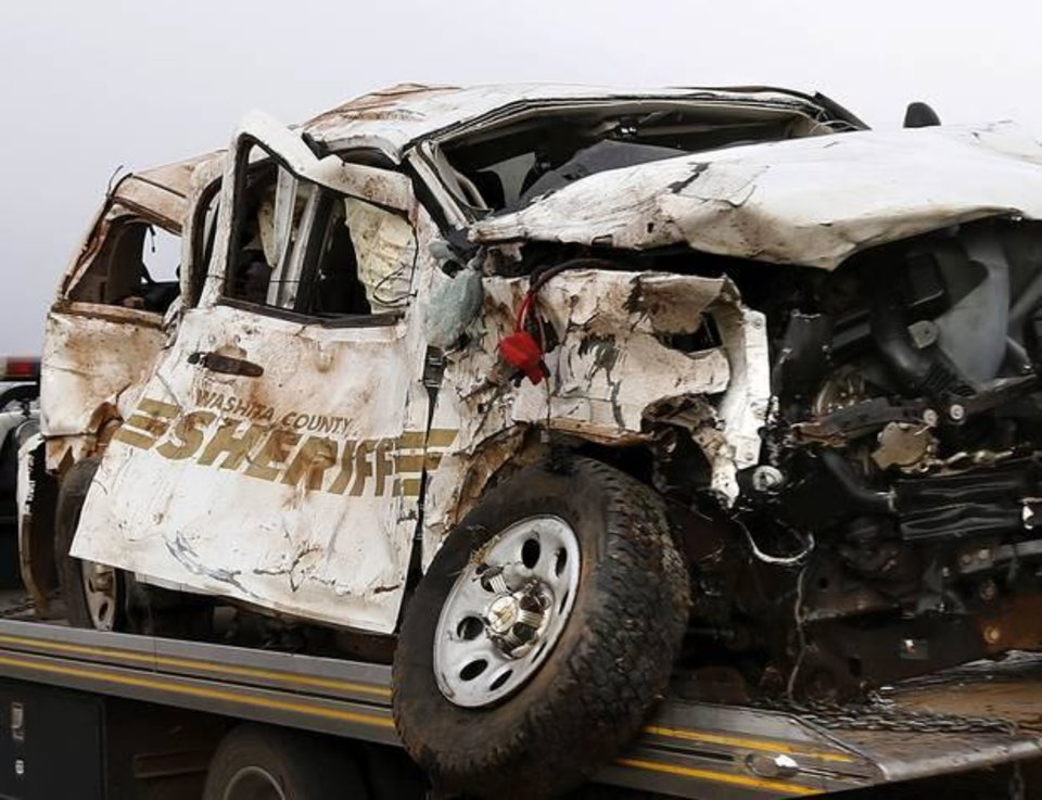 Photo - A Burns Flat police officer and an undersheriff for the Washita County Sheriff's Department died in a crash Thursday at a rural intersection south of Dill City.  Photo by Jim Beckel, The Oklahoman