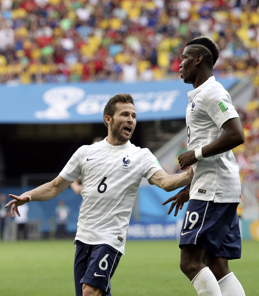 Photo - France's Paul Pogba, right, celebrates with Yohan Cabaye after scoring his side's opening goal during the World Cup round of 16 soccer match between France and Nigeria at the Estadio Nacional in Brasilia, Brazil, Monday, June 30, 2014.  (AP Photo/David Vincent)