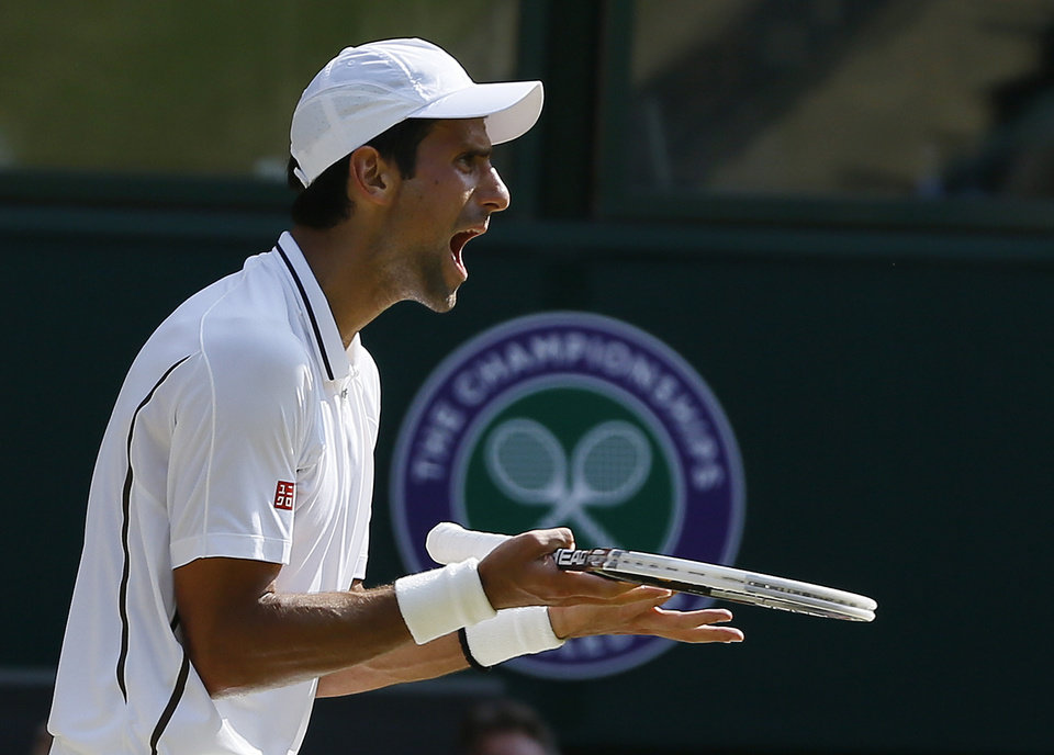 Photo - Novak Djokovic of Serbia reacts during the Men's singles final match against Andy Murray of Britain at the All England Lawn Tennis Championships in Wimbledon, London, Sunday, July 7, 2013. (AP Photo/Kirsty Wigglesworth)