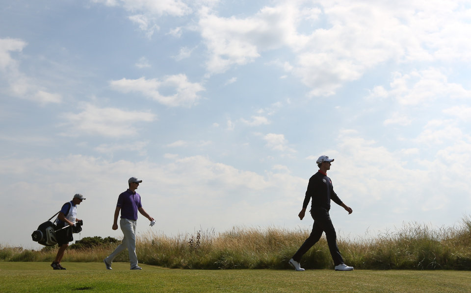 Photo - Adam Scott of Australia, right, and Justin Rose of England walk along the 4th fairway during the second day of the British Open Golf championship at the Royal Liverpool golf club, Hoylake, England, Friday July 18, 2014. (AP Photo/Jon Super)
