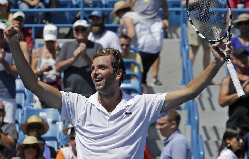 Photo - Julien Benneteau, from France, celebrates after upsetting Stan Wawrinka, from Switzerland, 1-6, 6-1, 6-2, during a match at the Western & Southern Open tennis tournament, Friday, Aug. 15, 2014, in Mason, Ohio. (AP Photo/Al Behrman)