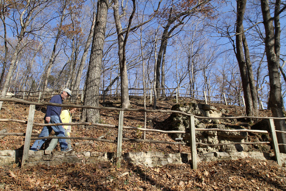 Photo - FILE-- In this Nov. 8, 2010 file photo, Paul and Sue Schramm, of Dyersville, Iowa, hike one of the trails at Effigy Mounds National Monument in Harpers Ferry, Iowa. Records show that National Park Service officials approved $3 million in illegal construction projects over a decade that damaged one of the nation's most sacred Indian burial sites. (AP Photo/The Des Moines Register, Justin Hayworth, File) MAGS OUT; TV OUT; NO SALES; MANDATORY CREDIT