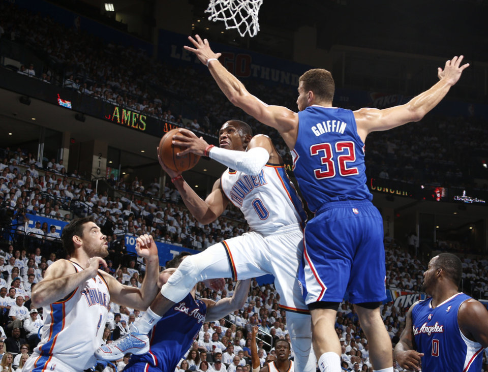 Photo - Russell Westbrook (0) drives by Blake Griffin (32) during Game 5 of the Western Conference semifinals in the NBA playoffs between the Oklahoma City Thunder and the Los Angeles Clippers at Chesapeake Energy Arena in Oklahoma City, Tuesday, May 13, 2014. Photo by Sarah Phipps, The Oklahoman