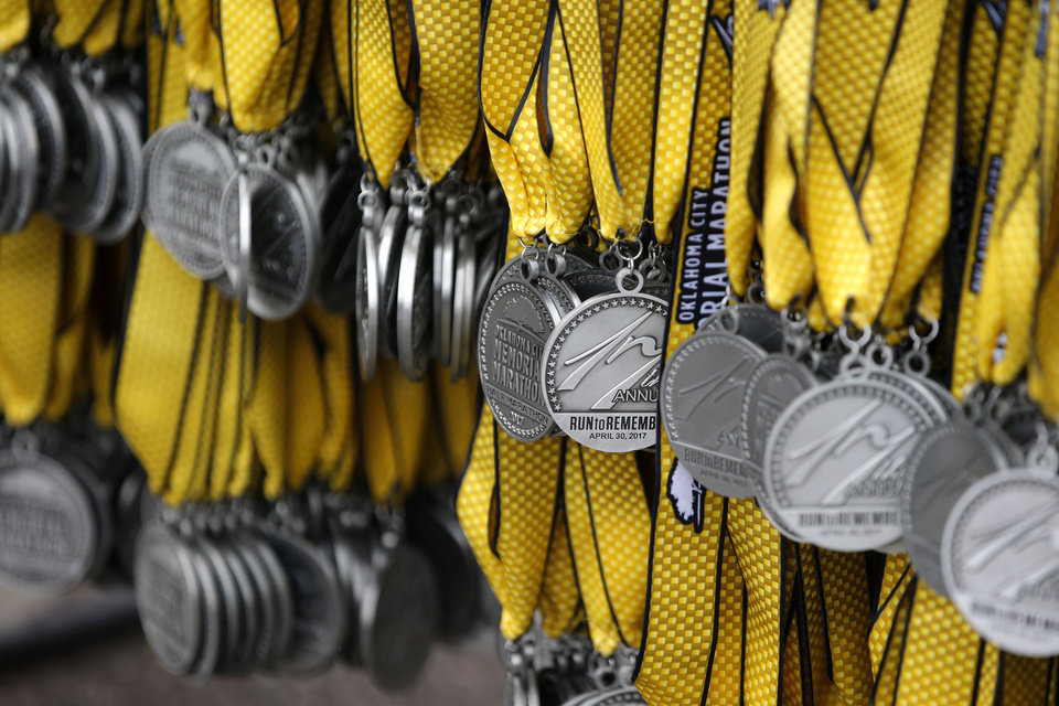Photo - Medals for the Oklahoma City Memorial Marathon are seen in Oklahoma City, Sunday, April 30, 2017. Photo by Bryan Terry, The Oklahoman