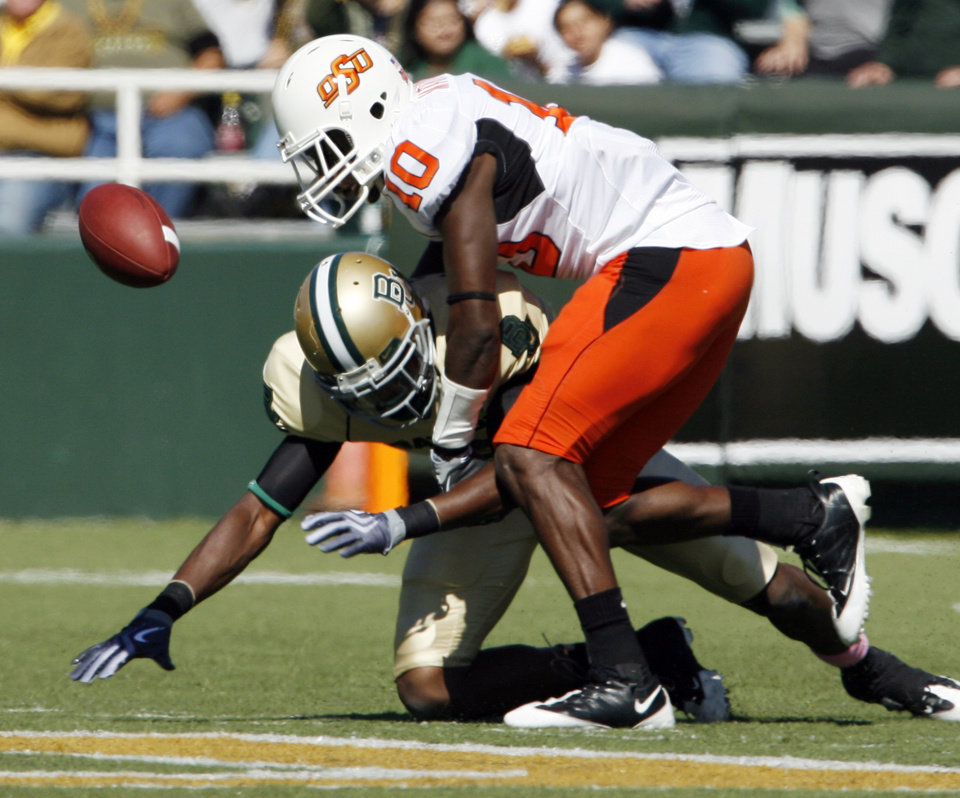 Photo - Markelle Martin (10) breaks up a pass intended for Ernest Smith (3) during the college football game between Baylor University and Oklahoma State University (OSU) at Floyd Casey Stadium in Waco, Texas, on Saturday, Oct. 24, 2009.  Photo by Steve Sisney, The Oklahoman