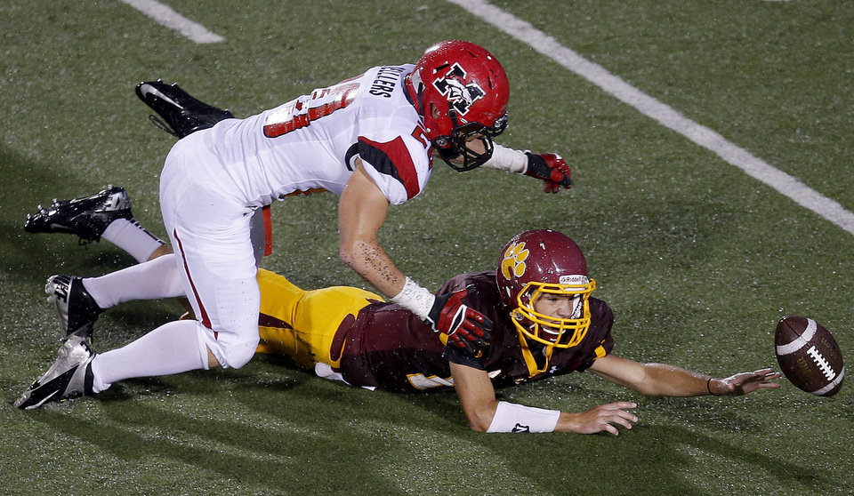 Mustang's Dakota Sellers, left, and Putnam City North's Chase Sparks go after a Putnam City North fumble during their high school football game at Putnam CIty High School in Oklahoma City, Thursday, Sept. 12, 2013. Putnam City North recovered the ball. Photo by Bryan Terry, The Oklahoman