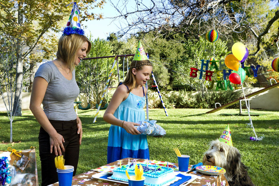 Photo -  When single mom Megan (Candace Cameron Bure) and her daughter Caitlin (Katie Hawkins) adopt a lovable pound puppy (Bug Z) from a shelter, they waste no time making him a permanent part of the family! Photo:  Copyright 2012 Crown Media Holdings, Inc./Photographer Alexx Henry
