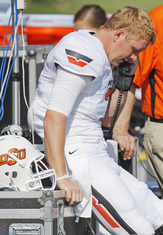 Photo - Oklahoma State's Brandon Weeden (3) talks with coaches in the press box during a college football game between the Oklahoma State University Cowboys (OSU) and the University of Missouri Tigers (Mizzou) at Faurot Field in Columbia, Mo.,  OSU won, 45-24. Saturday, Oct. 22, 2011. Photo by Nate Billings, The Oklahoman ORG XMIT: KOD
