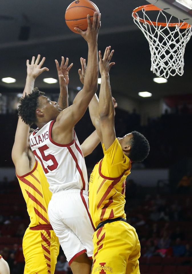 Photo - Oklahoma's Alondes Williams (15) goes to the basket between Iowa State's George Conditt IV (4) and Rasir Bolton (45) during an NCAA basketball game between the University of Oklahoma Sooners (OU) and the Iowa State Cyclones at the Lloyd Noble Center in Norman, Okla., Wednesday, Feb. 12, 2020. [Bryan Terry/The Oklahoman]