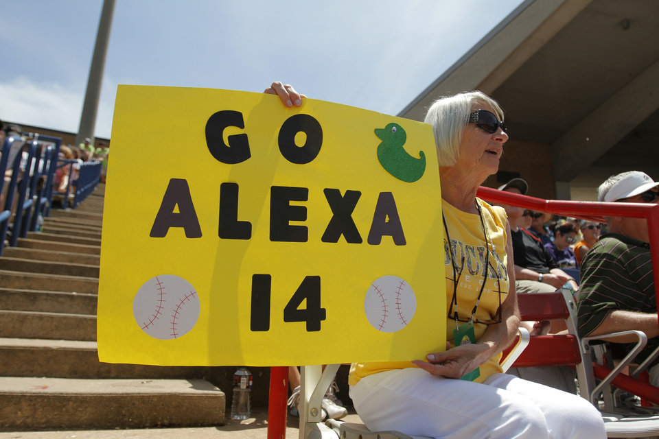 Sue Weaver cheers for her granddaughter Alexa Peterson (14) during a Women's College World Series game between Tennessee and Oregon at ASA Hall of Fame Stadium in Oklahoma City, Saturday, June 2, 2012. Photo by Garett Fisbeck, The Oklahoman