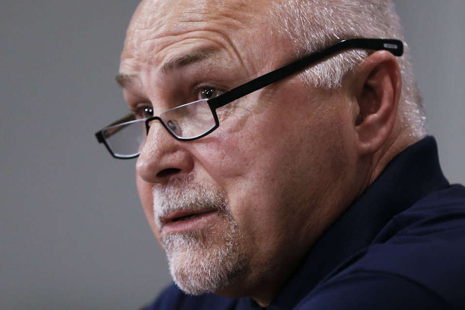 Photo - Nashville Predators head coach Barry Trotz answers questions at a news conference Monday, April 14, 2014, in Nashville, Tenn. The Predators announced earlier in the day that Trotz's contract won't be extended and they will begin looking for a new head coach. Trotz is the only head coach the NHL hockey team has had. (AP Photo/Mark Humphrey)