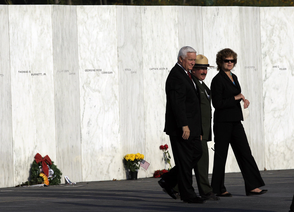 Pennsylvania Gov. Tom Corbett, left walks with his wife Susan after viewing the Wall of Names near the crash site of Flight 93 in Shanksville, Pa. Sunday Sept. 11, 2011. (AP Photo/Amy Sancetta)