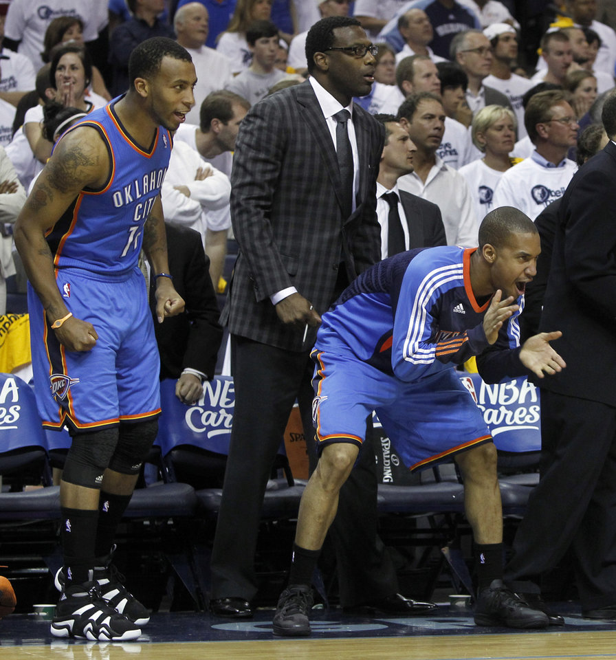 Photo - Oklahoma City Thunder guard Eric Maynor, right, celebrates in the final moments of the third overtime of Game 4 against the Memphis Grizzlies in a second-round NBA basketball playoff series on Tuesday, May 10, 2011, in Memphis, Tenn. Oklahoma City won 133-123 in triple overtime. At left is Daequan Cook (14). (AP Photo/Lance Murphey)