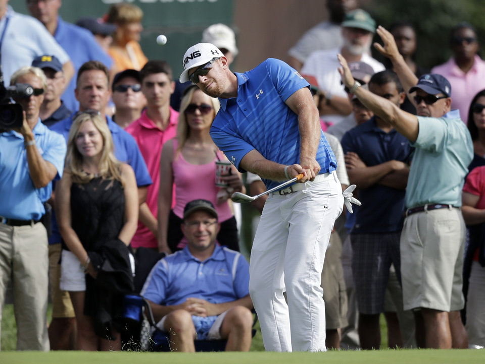 Photo - Hunter Mahan chips onto the green on the 18th hole during the third round of play at The Barclays golf tournament Saturday, Aug. 23, 2014, in Paramus, N.J. (AP Photo/Mel Evans)